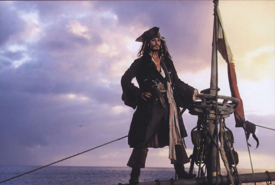 "Johnny Depp portrayed Capt. Jack Sparrow in the ""Pirates of the Caribbean"" movies. Depp's ""The Curse of the Black Pearl"" and other period movies are the focus of ""CUT! Costume and the Cinema,"" one of two costume design exhibits at the McNay Art Museum. Photo: Walt Disney Pictures"
