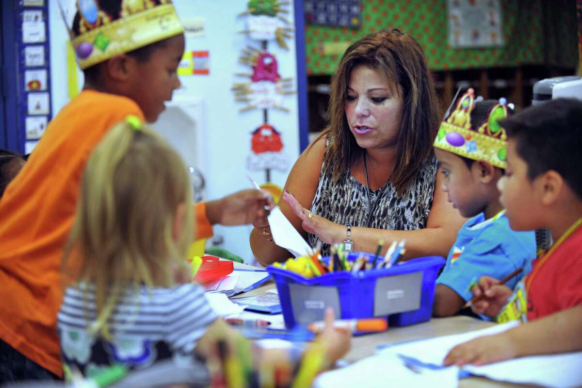 Elizabeth Smith, a kindergarten teacher at Hayestown Avenue Elementary School, works with her class during the conferencing portion of a writing workshop, Wednesday, Oct. 2, 2013. Smithis Danbury's Teacher of the Year for 2013.