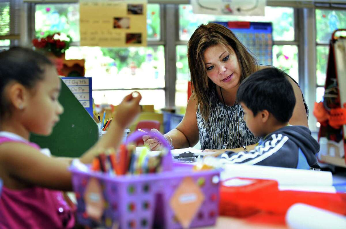 Elizabeth Smith, a kindergarten teacher at Hayestown Avenue Elementary School, is Danbury, Conn's teacher of the year for 2013. Wednesday, Oct. 2, 2013, she works with Eric Patino during the conferencing portion of a writing workshop.