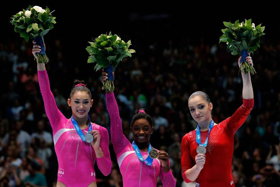 Simone Biles stands with fellow medal-winners at the gymnastics World Championships. Photo: Dean Mouhtaropoulos, Getty Images