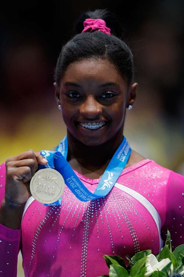 Simone Biles reacts after receiving her gold medal. Photo: Dean Mouhtaropoulos, Getty Images