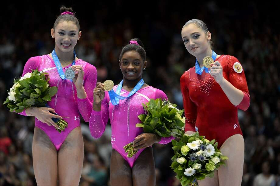 Simone Biles stands with fellow medal-winners at the gymnastics World Championships. Photo: Dirk Waem, Getty Images