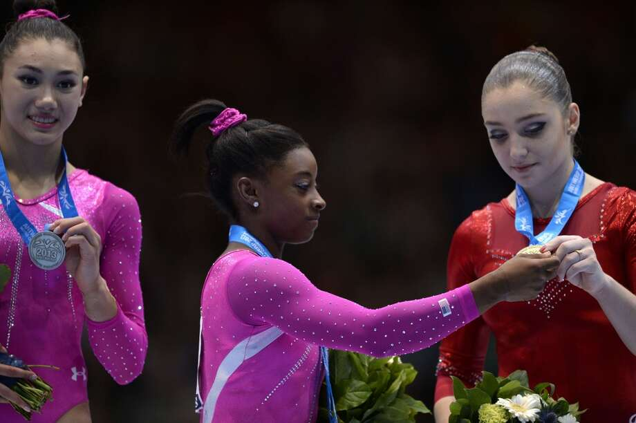 Simone Biles stands with fellow medal-winners at the gymnastics World Championships. Photo: Martin Bureau, Getty Images