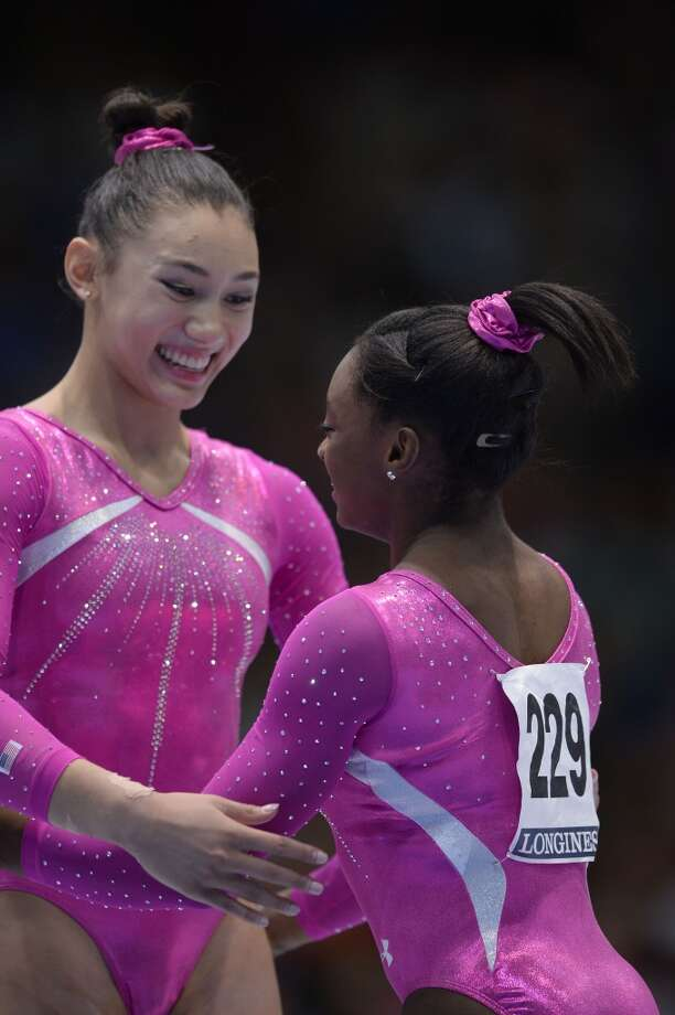 All-around gymnastics world champion Simone Biles and runner-up Kyla Ross celebrate. Photo: Martin Bureau, Getty Images