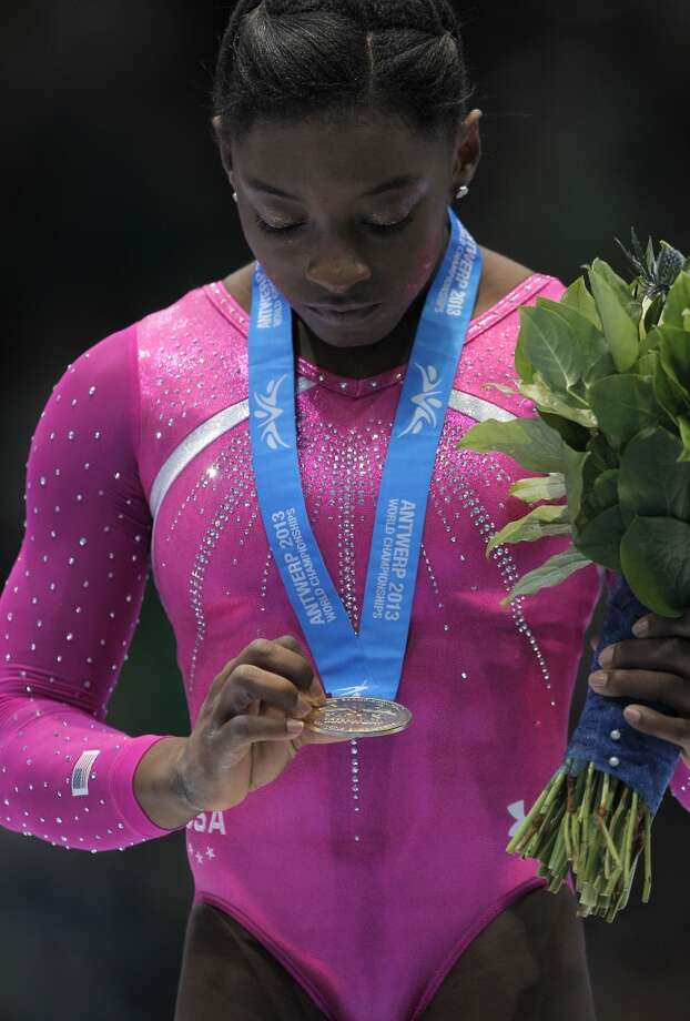 Simone Biles reacts after receiving her gold medal. Photo: Yves Logghe, Associated Press