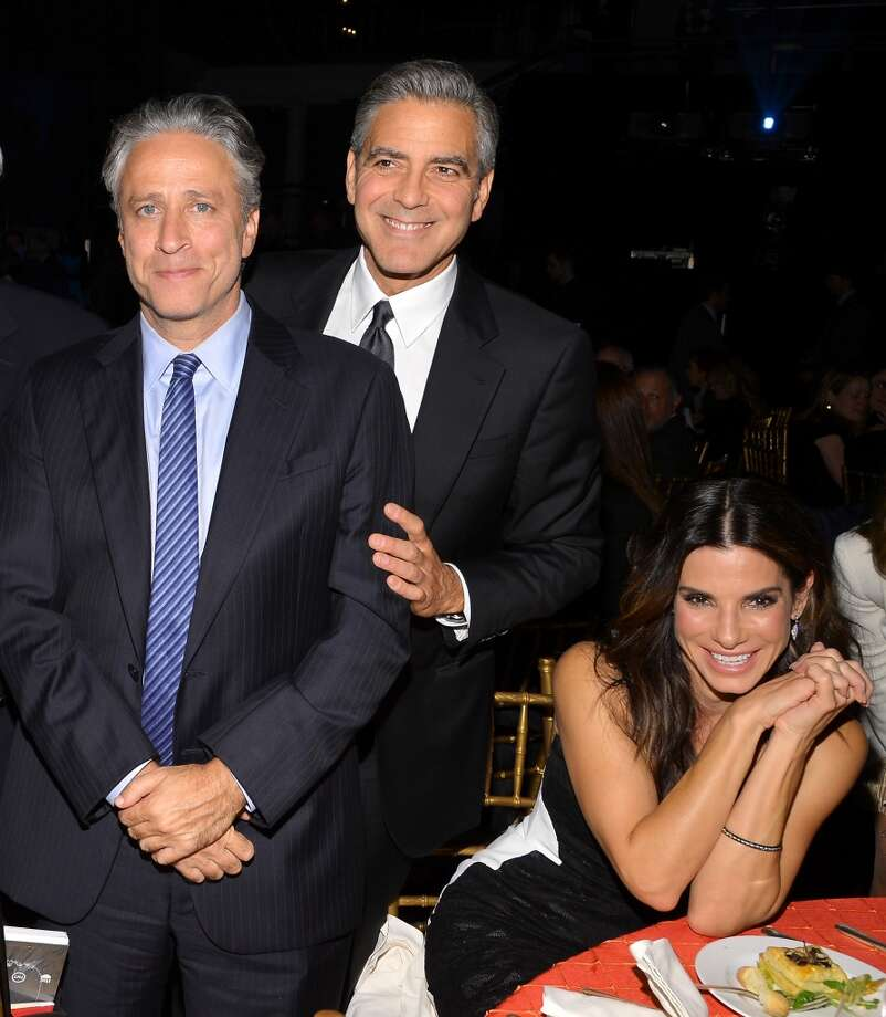 (L-R) Jon Stewart, and actors George Clooney and Sandra Bullock attend the USC Shoah Foundation Institute 2013 Ambassadors for Humanity gala at the American Museum of Natural History on October 3, 2013 in New York, New York.  (Photo by Larry Busacca/Getty Images for the USC Shoah Foundation Institute) Photo: Larry Busacca, (Credit Too Long, See Caption)