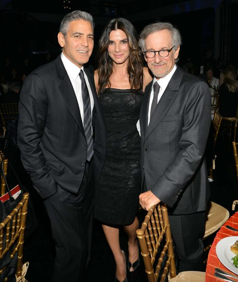 (L-R) Actors George Clooney, Sandra Bullock and director Steven Spielberg attend the USC Shoah Foundation Institute 2013 Ambassadors for Humanity gala at the American Museum of Natural History on October 3, 2013 in New York, New York.  (Photo by Larry Busacca/Getty Images for the USC Shoah Foundation Institute) Photo: Larry Busacca, Getty Images For The USC Shoah F