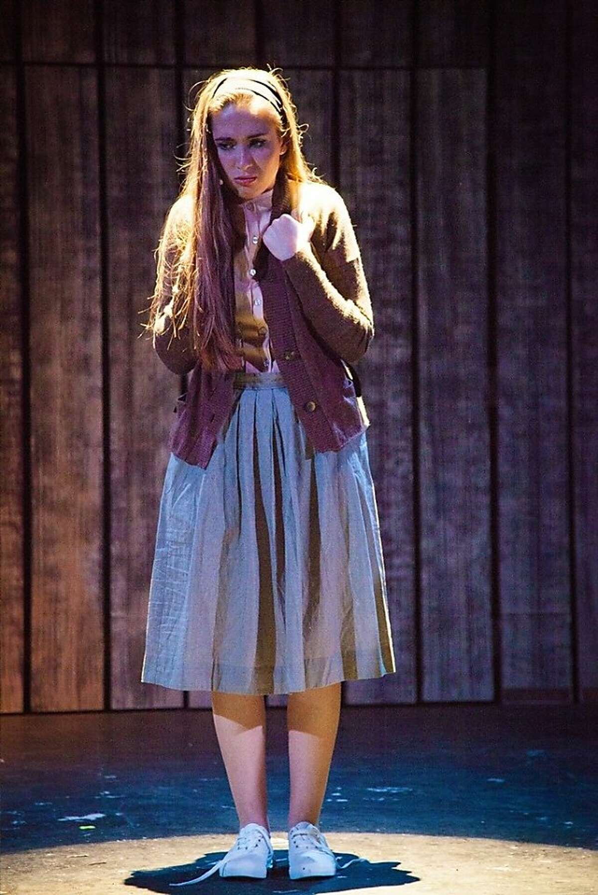 Carrie (Cristina Ann Oeschger) struggles to control the forces inside her in Ray of Light's local premiere of