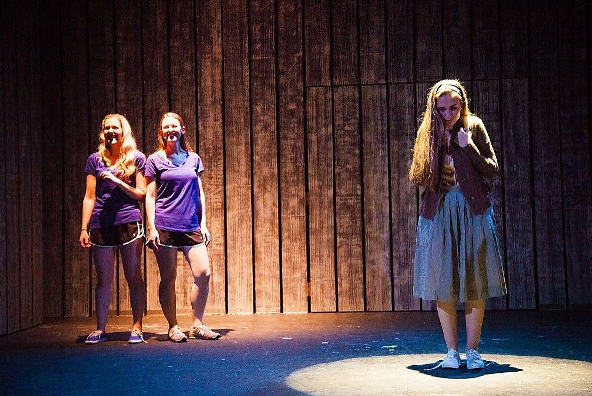 Carrie (Cristina Ann Oeschger, right) is taunted by popular girls Chris (Riley Krull, left) and Sue Snell (Courtney Merrell), in Ray of Light's local premiere of