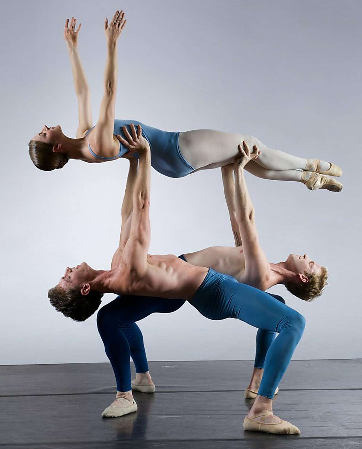 Smuin_Kylian3_KeithSutter: Smuin Ballet dancer Jane Rehm is lifted by Jonathan Dummar (left) and Joshua Reynolds (right) in Jir Kyli n s Return to a Strange Land, part of Smuin's XXtremes Fall Program playing October 4-12 at San Francisco's Palace of Fine Arts. Photo credit