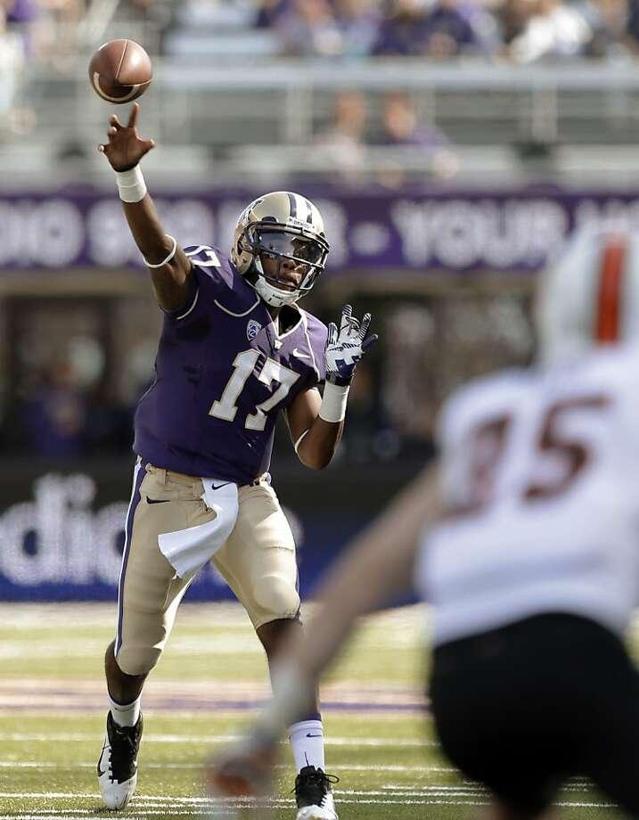 Keith Price runs a hurry-up offense in his senior season as Washington's quarterback. Photo: Elaine Thompson, Associated Press
