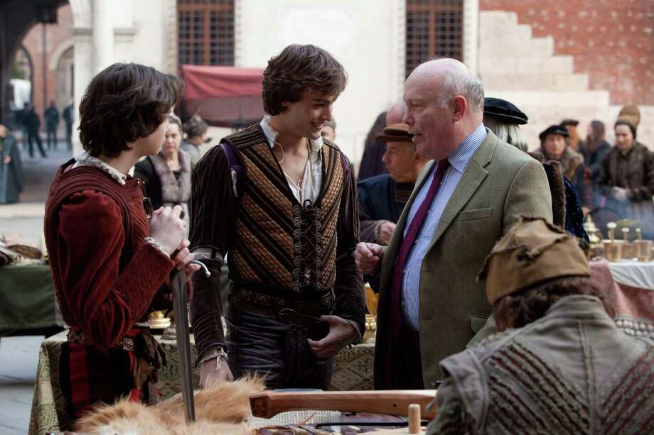 """Romeo & Juliet"" screenwriter Julian Fellowes, right, consults with Douglas Booth, who portrays Romeo, on the set. Photo: -- / ©2013 R & J Releasing, Ltd.  All Rights Reserved."