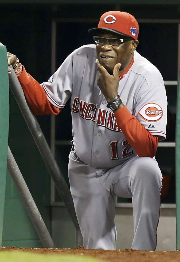 Dusty Baker watches from the dugout in what turned out to be his last game as Reds manager, a wild-card loss to the Pirates. Photo: Gene J. Puskar, Associated Press