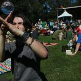 Ben Bonyhadi, 23, practices the art of contact juggling during the first day of the Hardly Strictly Bluegrass festival in Golden Gate Park October 4, 2013 in San Francisco, Calif.