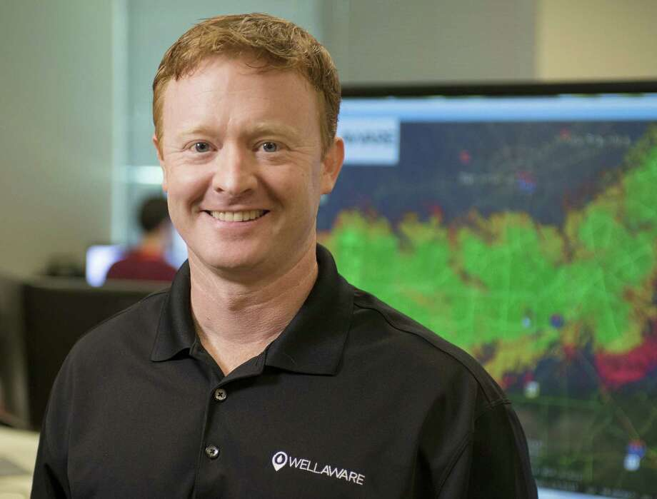 WellAware CEO Matt Harrison's technology monitors wells, pipelines and other oil-field equipment in real time, remotely. Photo: Darren Abate / For The San Antonio Express-News