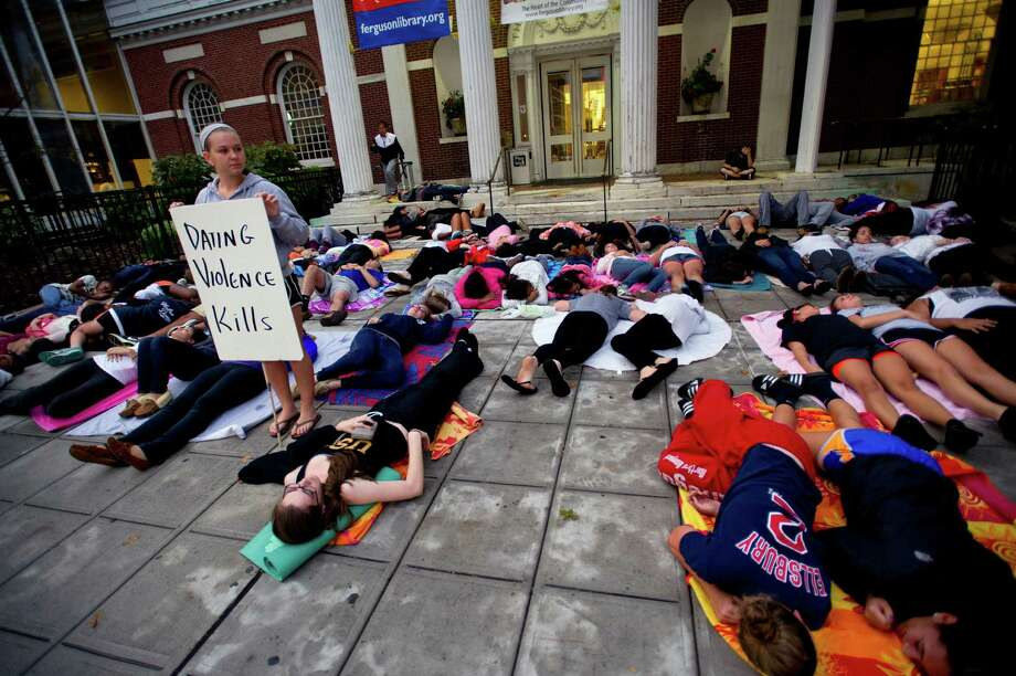 "Members of the Mayor's Youth Leadership Council ""drop dead"" for 35 minutes to raise awareness of bullying and dating violence outside the Ferguson Library in Stamford, Conn., on Friday, October 4, 2013. Photo: Lindsay Perry / Stamford Advocate"