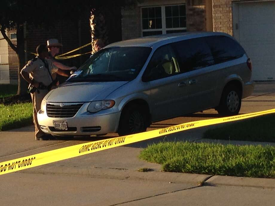 The scene of a raided home in Fort Bend. Photo: Mike Glenn, Houston Chronicle