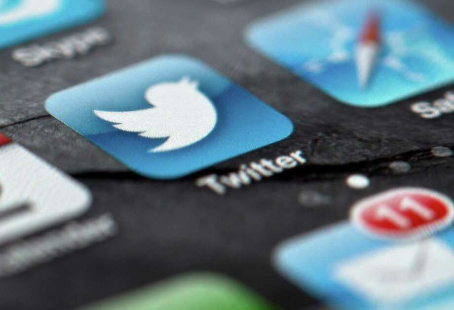 FILE - In this Feb. 2, 2013, file photo, a smartphone display shows the Twitter logo in Berlin, Germany, Twitter unsealed the documents Thursday, Oct. 3, 2013, for its planned initial public offering of stock and says it hopes to raise up to $1 billion. (AP Photo/dpa, Soeren Stache, File) ORG XMIT: NYBZ185 Photo: Soeren Stache / dpa