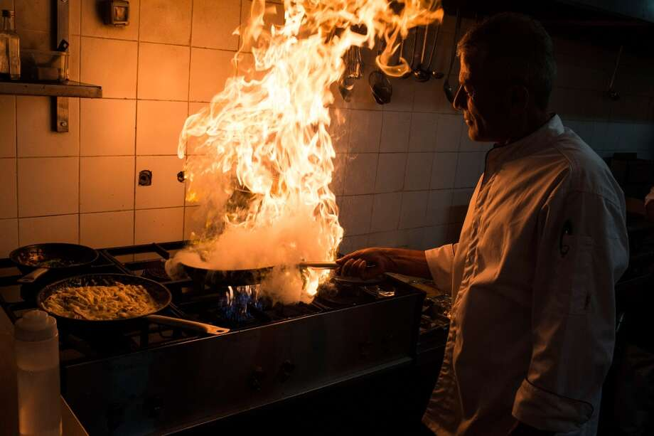 West Bank: A chef cooks a meal in a restaurant in Ramallah, West-Bank. The West Bank and Gaza Strip are inhabited by an estimated 3.33 million Palestinians who live in a region which has a long history as a crossroads for religion, culture, commerce and politics. Photo: Ilia Yefimovich, Getty Images