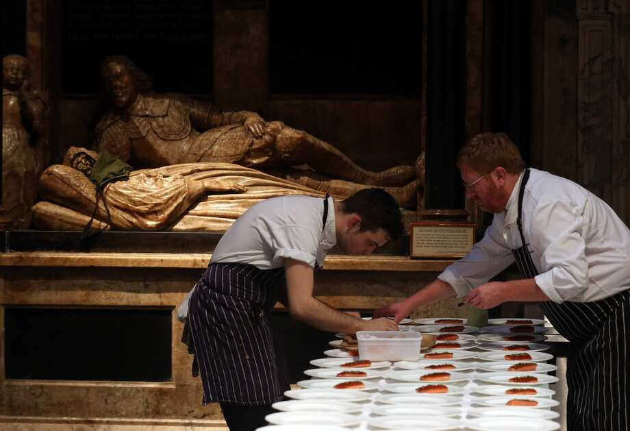 England:  Catering students from the City of Bath College prepare food for more than a 100 diners inside the Bath Abbey in Bath, England. Diners paid 95 GBP for tickets for the three course meal that was cooked by three Michelin starred chefs and then prepared and served by catering students from the City of Bath College at the historic city centre church.  The event was a charity curtain raiser, beginning a month long festival celebrating the best of Bath's food and drink. Photo: Matt Cardy, Getty Images