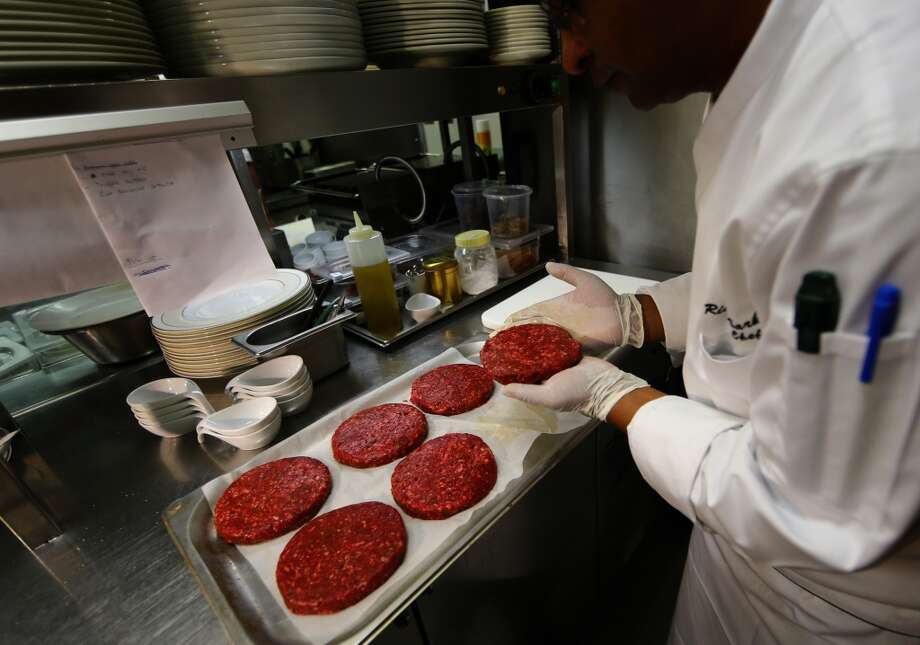 United Arab Emirates: A chef at a luxurious hotel in Abu Dhabi prepares raw camel meat in the form of burgers. From camel carpaccio to camel bourguignon and gold-leaf burger, the meat offered traditionally at big festivities of bedouins has become a fancy ingredient in the Gulf's prestigious restaurants. Photo: Marwan Naamani, AFP/Getty Images
