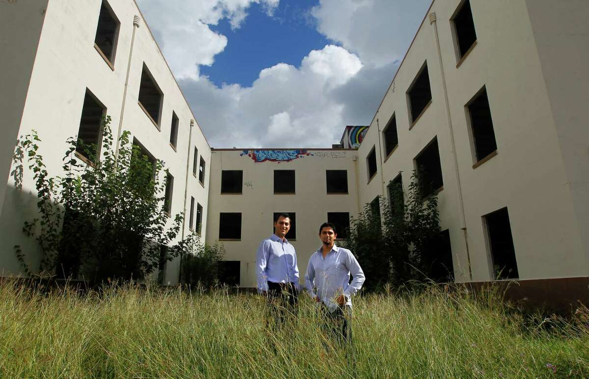 Gaurav Khandelwal, left, and Apurva Sanghavi, right, stand in front of the former Schlumberger building at the corner or Leeland and Delano Streets, Wednesday, Oct. 2, 2013, in Houston. The two plan to redevelop the building in the East End. (Cody Duty / Houston Chronicle)