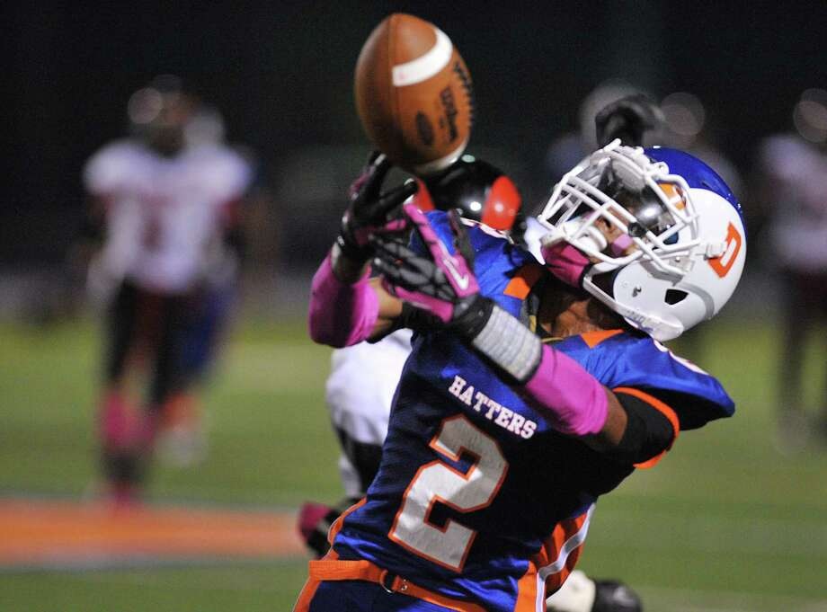 Danbury's Elijah Duffy reaches out for the ball in the FCIAC high school football game between Danbury and Bridgeport Central at Danbury High School in Danbury, Conn. on Friday, Oct. 4, 2013. Photo: Tyler Sizemore / The News-Times