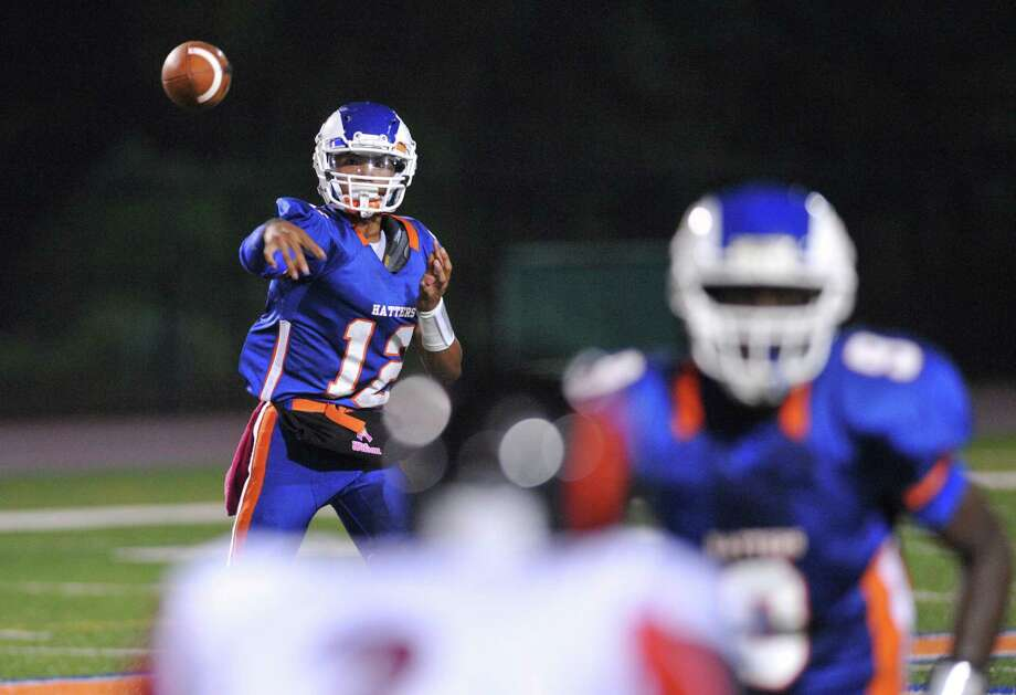 Danbury quarterback Anferney Ith throws a pass in the FCIAC high school football game between Danbury and Bridgeport Central at Danbury High School in Danbury, Conn. on Friday, Oct. 4, 2013. Photo: Tyler Sizemore / The News-Times