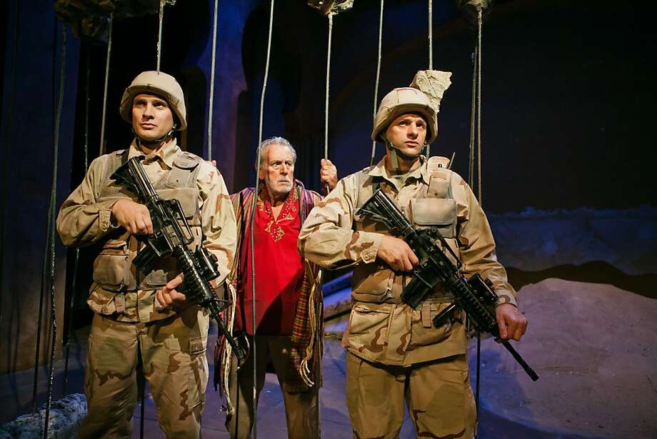 The Tiger (Will Marchetti) is guarded by two Marines at the zoo in Baghdad. Photo: Jessica Palopoli