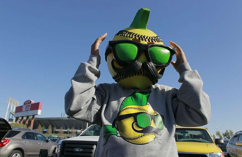 Juju Iribarren, 11, wears a baseball mask in the O.co Coliseum parking lot before the A's play the Detroit Tigers. Photo: Michael Macor, The Chronicle