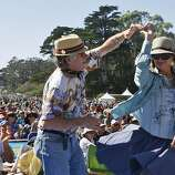 James Beldon and his fiance' Kimberly Bell dance together at the Hardly Strictly Bluegrass Festival in Golden Gate Park, in San Francisco, Ca, on Friday, Oct. 4, 2013.