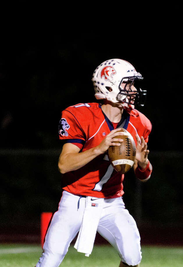 Foran's quarterback Jake Kasuba (7) looks to pass during the football game against Shelton at Foran High School in Milford on Friday, Oct. 4, 2013. Photo: Amy Mortensen / Connecticut Post Freelance