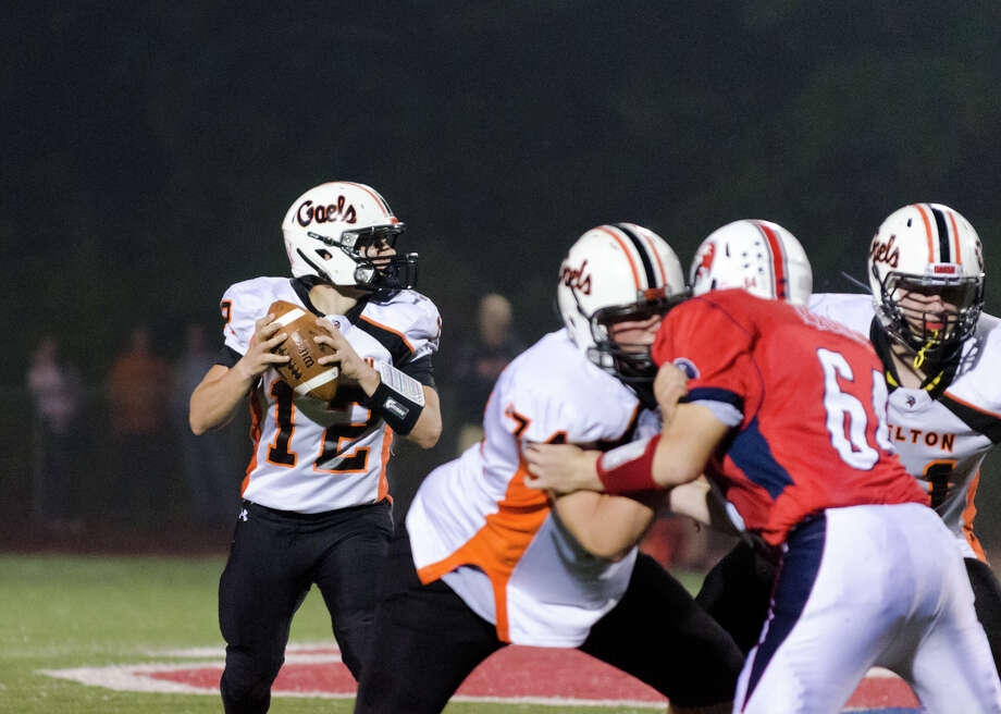 Shelton's quarterback Mark Piccirillo (12) looks to pass during the football game against Foran at Foran High School in Milford on Friday, Oct. 4, 2013. Photo: Amy Mortensen / Connecticut Post Freelance