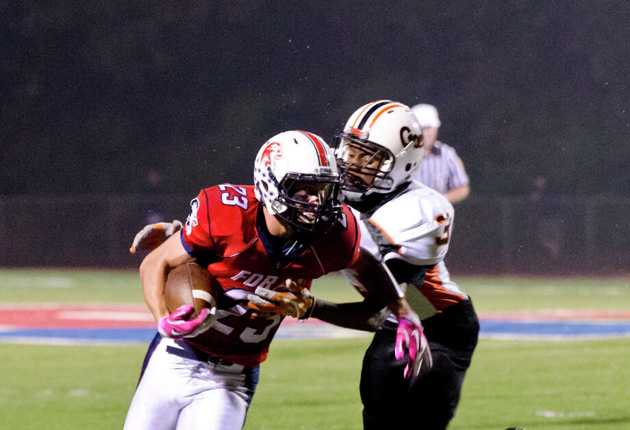 Shelton's Wadson Petithomme (3) defends against Foran's Connor Cadrin (23) during the football game at Foran High School in Milford on Friday, Oct. 4, 2013. Photo: Amy Mortensen / Connecticut Post Freelance