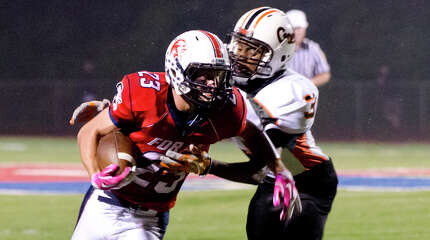 Shelton's Wadson Petithomme (3) defends against Foran's Connor Cadrin (23) during the football game at Foran High School in Milford on Friday, Oct. 4, 2013.
