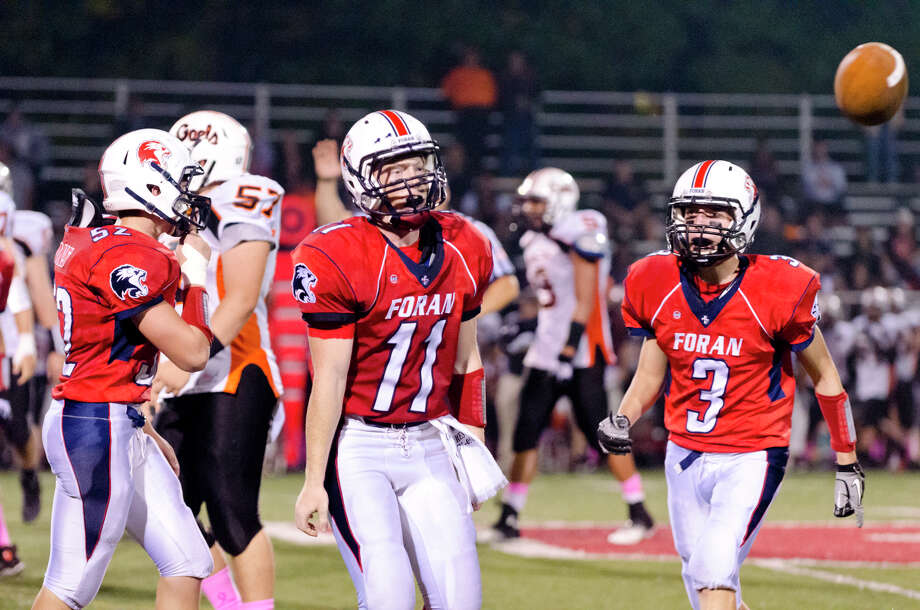 Foran's Samuel Olsson (11) cheers after recovering the ball during the football game against Shelton at Foran High School in Milford on Friday, Oct. 4, 2013. Photo: Amy Mortensen / Connecticut Post Freelance