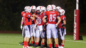 Foran's meets on the field during the football game against Shelton at Foran High School in Milford on Friday, Oct. 4, 2013.