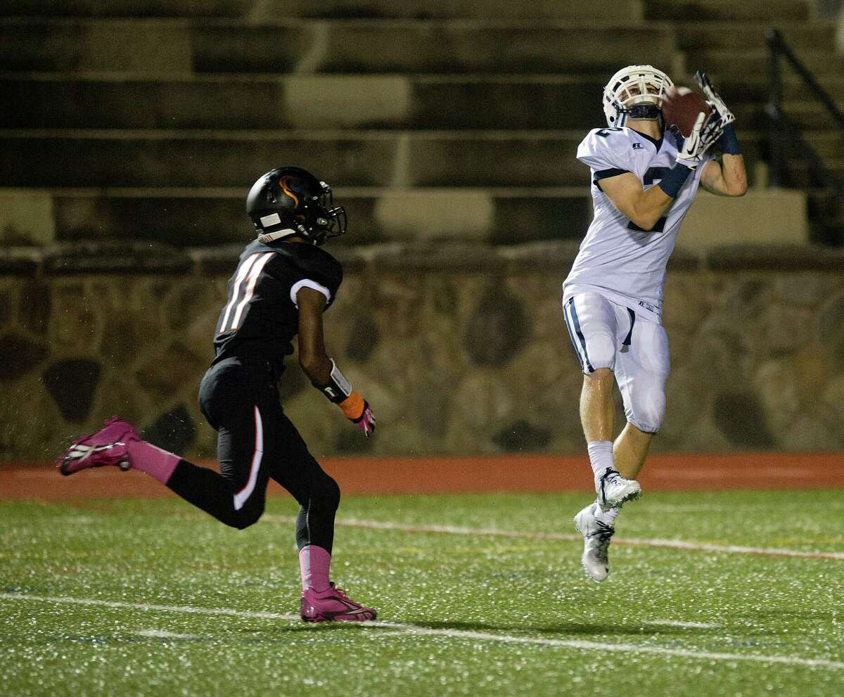 Staples' Will Johnson makes a catch and a touchdown during Friday's football game in Stamford, Conn., on October 4, 2013.