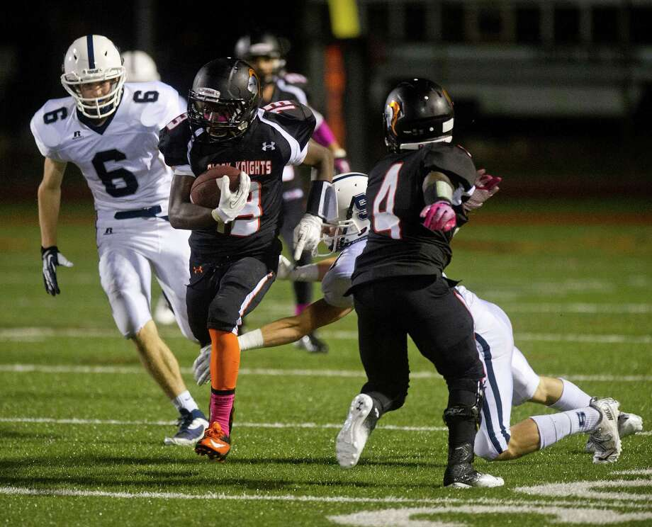 Stamford's Tyree Smith carries the ball during Friday's football game in Stamford, Conn., on October 4, 2013. Photo: Lindsay Perry / Stamford Advocate