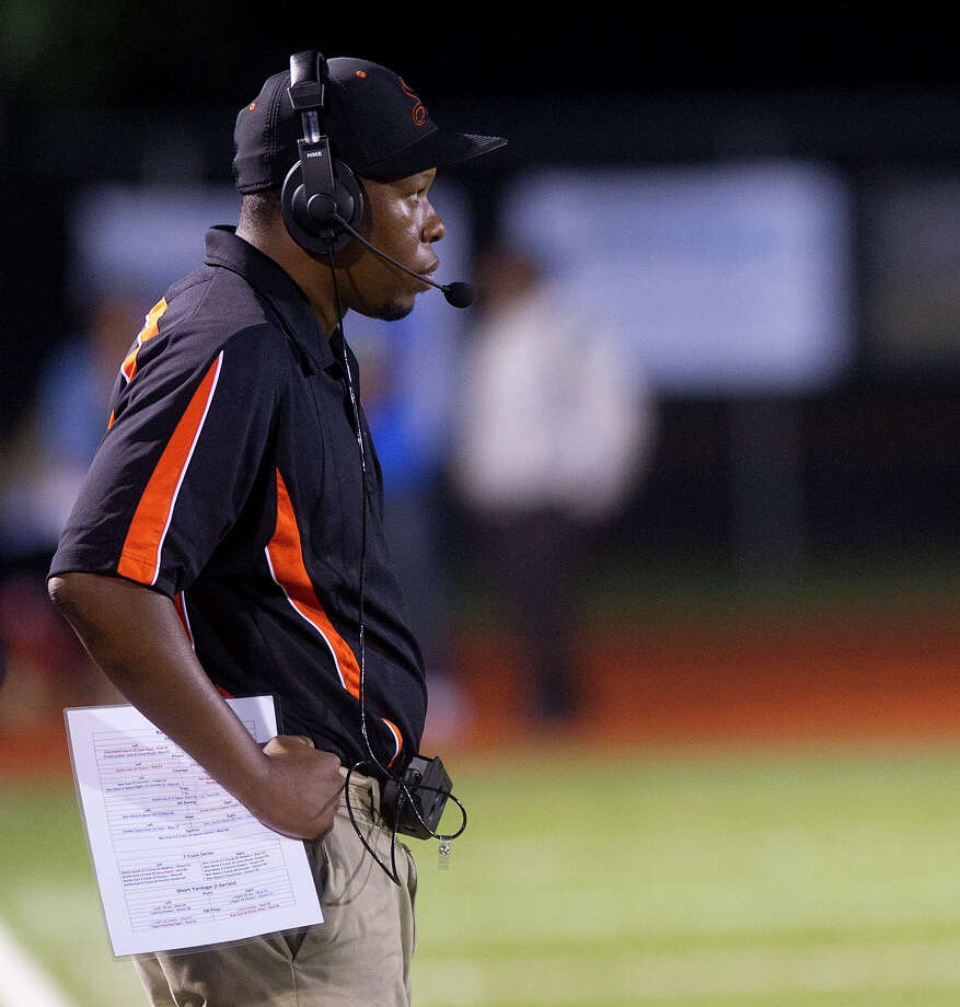 Stamford head coach Jamar Greene watches his team during Friday's football game in Stamford, Conn., on October 4, 2013. Photo: Lindsay Perry / Stamford Advocate