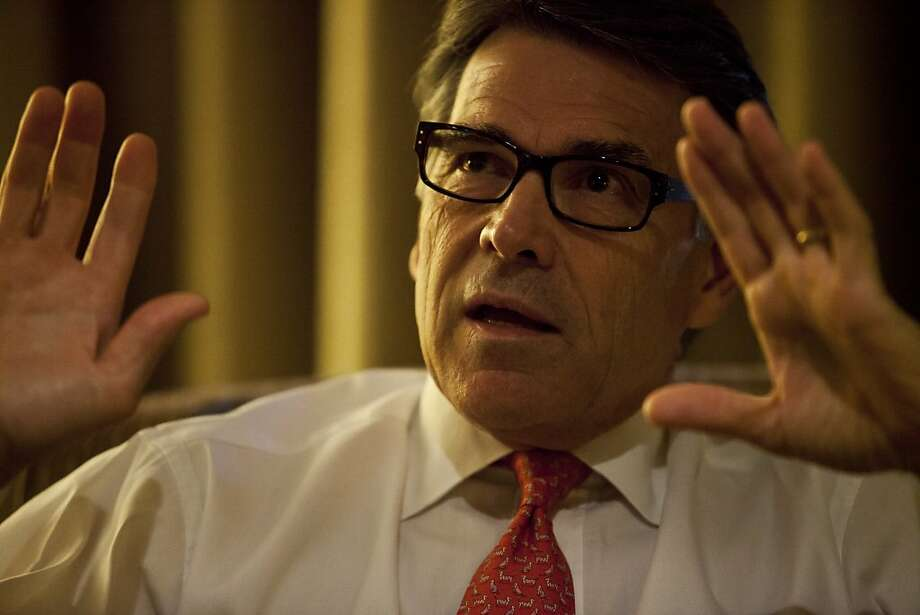 Texas Gov. Rick Perry is the state GOP convention's star attraction. Photo: Ted Soqui, Special To The Chronicle