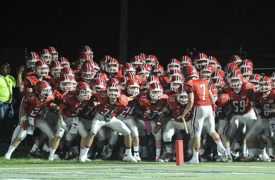 High School football game between New Canaan High School and Fairfield Warde High School at New Canaan, Friday night, Oct. 4, 2013. Photo: Bob Luckey / Greenwich Time