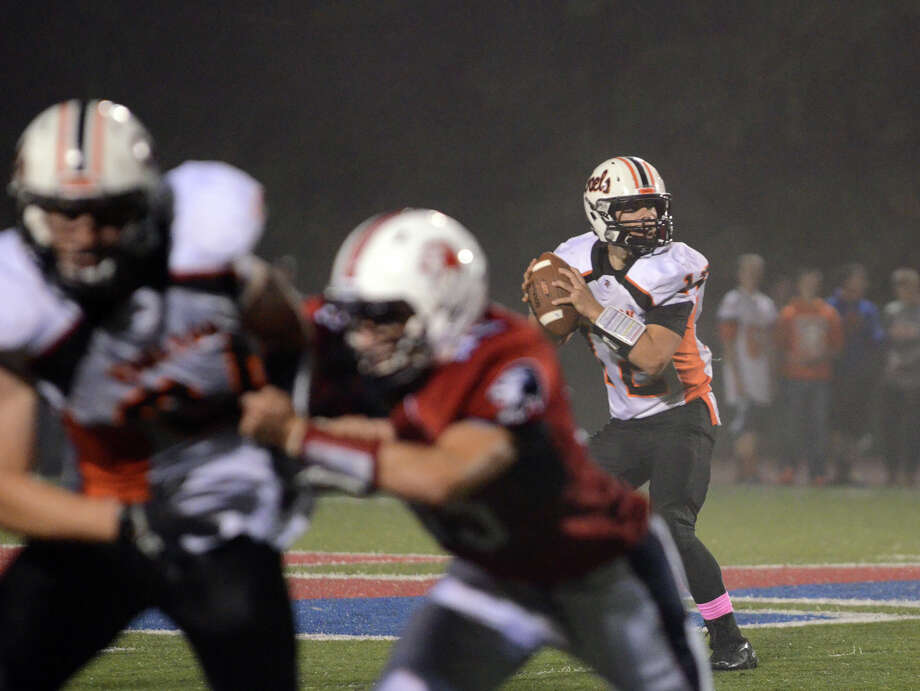 Shelton's Mark Piccirillo (12) looks to pass during the football game against Foran at Foran High School in Milford on Friday, Oct. 4, 2013. Photo: Amy Mortensen / Connecticut Post Freelance