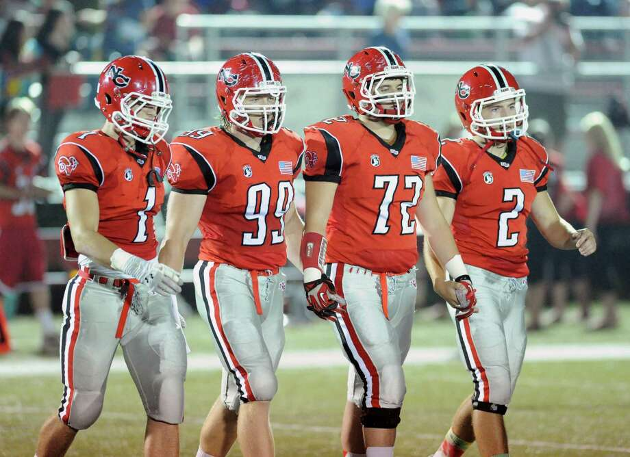 New Canaan football captains from left, Michael Root, Connor Buck, Joao Rocha and Cole Harris, during the start of the high School football game between New Canaan High School and Fairfield Warde High School at New Canaan, Friday night, Oct. 4, 2013. Photo: Bob Luckey / Greenwich Time