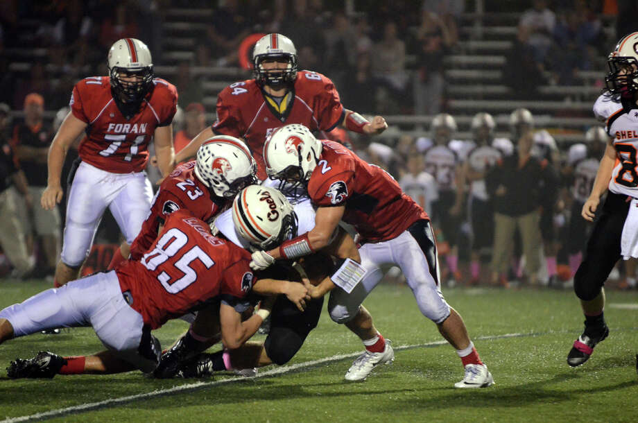 Foran's Nicholas Griswold (85), Connor Cadrin (23) and Nicholas Weissauer (2) stop Shelton ball carrier Jason Thompson (21) during the football game against Shelton at Foran High School in Milford on Friday, Oct. 4, 2013. Photo: Amy Mortensen / Connecticut Post Freelance