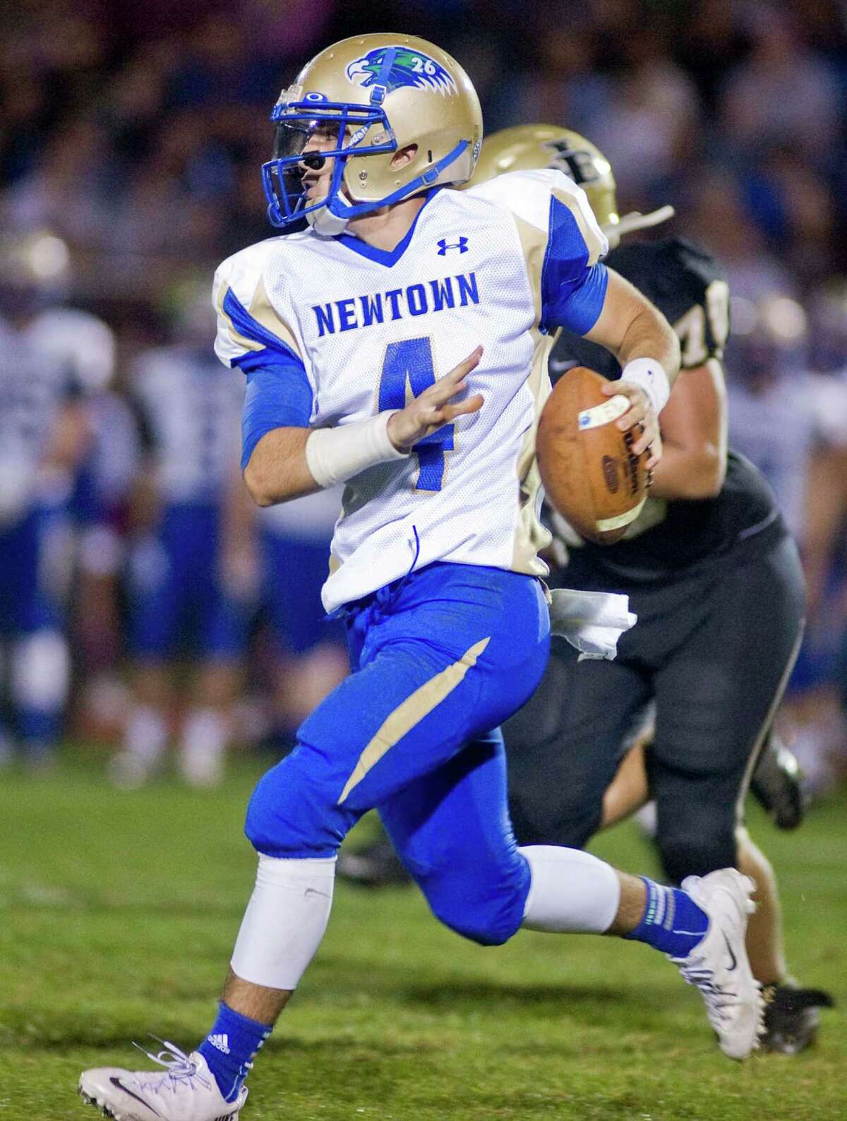 Newtown High School quarterback Andrew Tarantino looks for a receiver during a game against Joel Barlow, played at Joel Barlow High School. Friday, Oct. 4, 2013