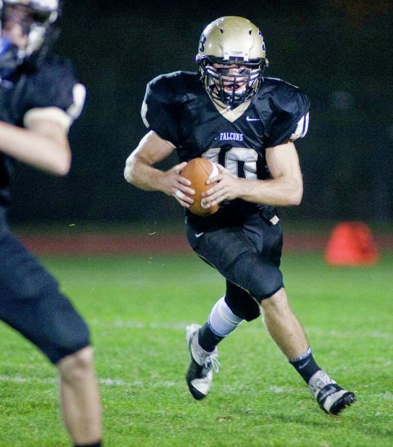 Joel Barlow quarterback Jack Shaban looks for running room during a game against Newtown High School, played at Joel Barlow High School. Friday, Oct. 4, 2013 Photo: Scott Mullin / The News-Times Freelance