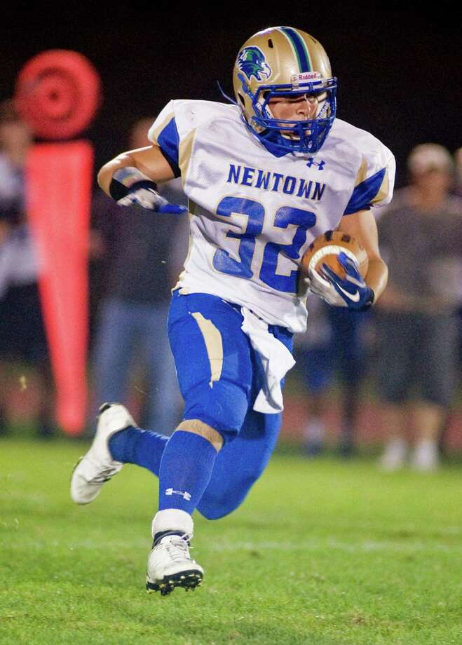 Newtown High School's Jaret Devellis heads up the field during a game against Joel Barlow High School, played at Barlow. Friday, Oct. 4, 2013 Photo: Scott Mullin / The News-Times Freelance