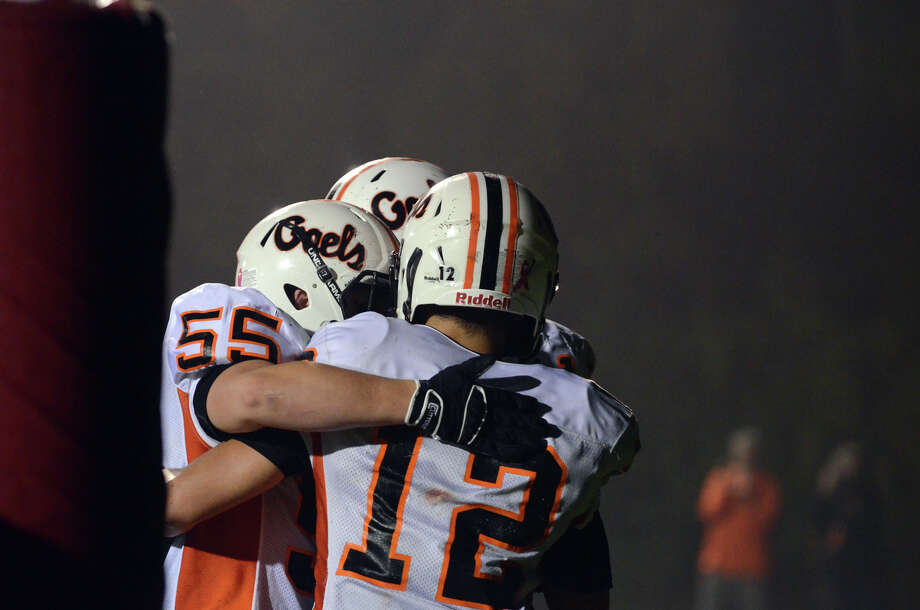 Shelton's Mark Piccirillo (12) celebrates with teammates in the end zone during the football game against Foran at Foran High School in Milford on Friday, Oct. 4, 2013. Photo: Amy Mortensen / Connecticut Post Freelance