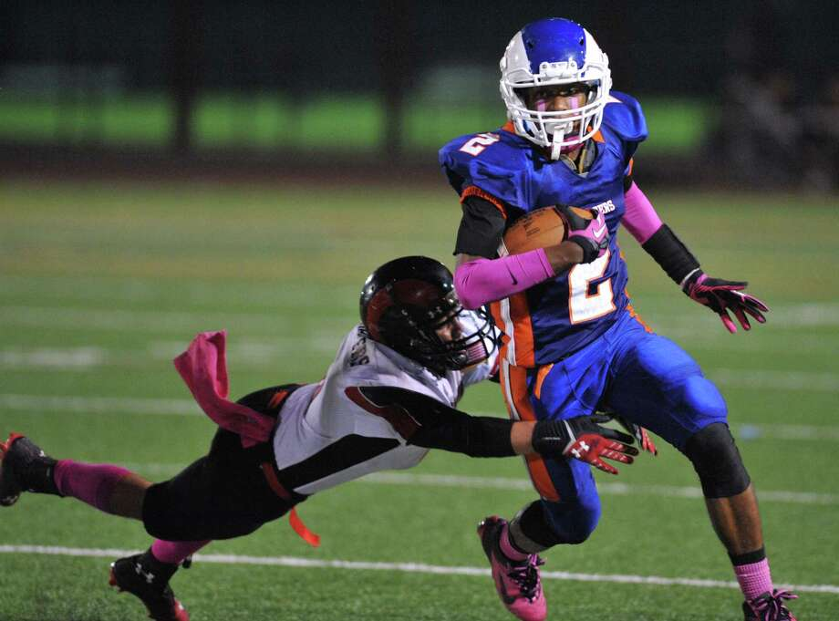 Danbury's Elijah Duffy breaks free in the FCIAC high school football game between Danbury and Bridgeport Central at Danbury High School in Danbury, Conn. on Friday, Oct. 4, 2013. Photo: Tyler Sizemore / The News-Times
